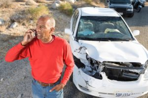 Man with crashed car. Car accident lawyer Plantation, FL